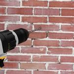 Во сколько обойдется сверление отверстий в кирпичной стене?